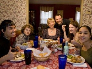 Photo of Multiracial Family Eating Dinner