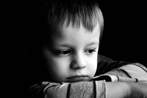 Sad little boy in black and white